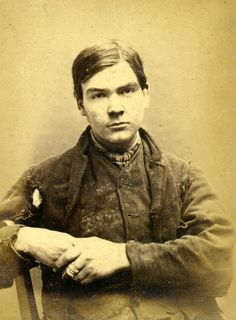 Mugshot: Patrick O'Neill (aged 19). Convicted of breaking into houses. Sentenced to 18 months in gaol. ca. 1870s.