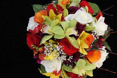 Gorgeous Fall Bridal Bouquet of green cymbidium orchids, Yellow Lilies, Red Roses, White Roses, Orange Calla Lilys, burgundy dahlias