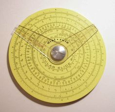 """Pickett circular slide rule with two cursors. (4.25 in/10.9 cm width) Reverse has additional scale and one cursor."" Caption at link"