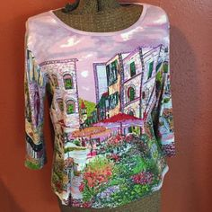 Take Two Cotton TShirt w sequins. Size L Take Two Cotton TShirt w sequins. Size L. Excellent condition. Bust measured flat 21 inches length 23 inches.  3/4 sleeves.   Scene on shirt is a courtyard with Italian buildings around it. Take Two Clothing Co.  Tops