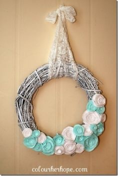 Winter wreath--white grapevine wreath with white and blue rolled fabric flowers