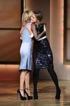 Tory Burch is congratulated by Jessica Alba