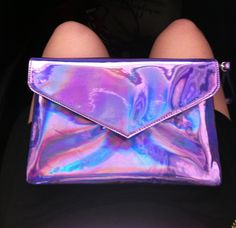 electrai:  ohtis:  pale-watermelon:  yaaaay new holographic purse!  omg the number of times I've reblogged this  same