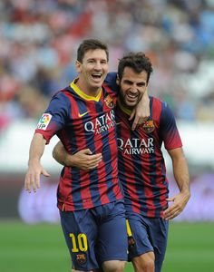 Lionel Messi (L) celebrates with Cesc Fabregas after scoring  on September 28, 2013 in Almeria, Spain.