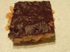 Pumpkin spiced rice krispie bars covered with dark chocolate.