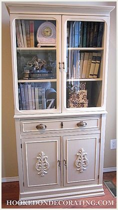 Carrie from Hooked on Decorating transformed this cabinet -- I think that the use of wood appliques really did the trick --