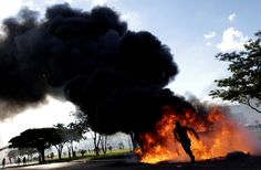 A demonstrator runs near a burning barricade during a protest against President Michel Temer and the latest corruption scandal to hit the country, in Brasilia, Brazil, May REUTERS/Ueslei Marcelino People Around The World, Around The Worlds, Manchester Attack, Al Jazeera, Photojournalism, Insta Pic, Amazing Photography, Brazil, Presidents