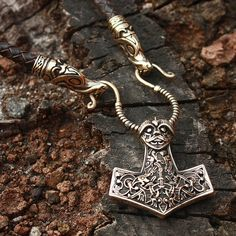 This is a real solid bronze 3-dimentional double sided hand-crafted antique finish pendant. The back side of the pendant also features a Tiwaz rune on the top of the pendant.  Thors hammer, or Mjolnir, is a very powerful Nordic protective amulet, a symbol of the creative powers of man. It is a really powerful shield from any negative energy channeled towards the owner of the pendant and also carries great support in new beginnings in life. It brings luck in those situations in life over…