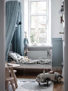 This delightful grey blue children's room is a dream.