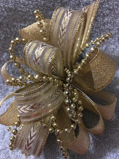 Items similar to Handmade Gold Hair Clip, Glitter Ribbon Hair Bow on Etsy Gold Hair Bow, Gold Hair Clips, Glitter Ribbon, Ribbon Hair Bows, Christmas Tree Toppers, Christmas Christmas, Xmas, Christmas Floral Arrangements, Gold Ribbons