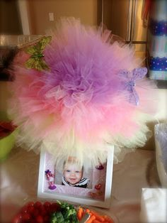 Tulle centerpiece with baby photo.