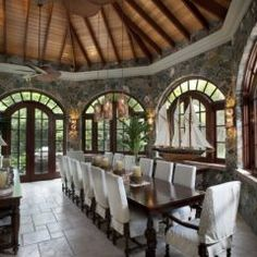 love the slip covered chairs  tropical dining room by Barefoot Design Group, LLC