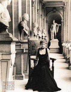 """Jamie Rishar in hall of sculpture in """"Stile Impero"""" for Vogue Italia, October 1993. Photograph by Arthur Elgort. """"Abito lungo di voile con corpino ricamato, Alberta Ferretti. Collier Sharra [Pagano] Archivio."""""""
