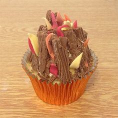 Bonfire Cupcake did with a marmalade butter cream with red and yellow colouring, flake sticks and choc orange matchmakers to build bonfire with a cocktail stick and mini marhsmallows sticking out the top.