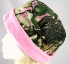 Pink camo fleece hat in Womens hat sizes XS to XXL The ladies have spoken and camouflage has gone pink.Handmade, cuffed brim pillbox or beanie hat made of soft