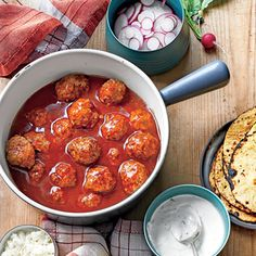 Tex-Mex Meatballs in Red Chile Sauce | MyRecipes.com Let guests doctor their own plates with crunchy, colorful toppings.