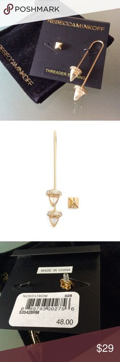 """BNWT Rebecca Minkoff – Acorn Ear Threader & Stud Brand new & authentic.    Reasonable offers always welcome but not interested to trade.    A glistening thread-through earring and a simple stud create a mismatched, but clearly coordinating, set elevated by cone-shaped jewels nestled within crystal-studded settings.  Thread-through style has 2"""" drop; 1/4"""" width. Thread-through style and post back. Yellow-goldtone plate/glass. Rebecca Minkoff Jewelry Earrings"""