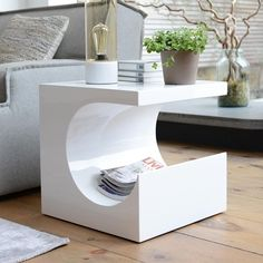 This cool side table which was inspired by Barbara Hepworth's iconic sculptures and makes a great side table for beside bed or sofa.  Its jigsaw piece aperture offers a unique storage space.