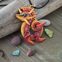 I absolutely adore this colourful sea dragon pendant! I drew inspiration from some sort of seahorse or eel pattern, can't recall which. It's a crazy colour combo, but it just makes me so happy when I look at it. Definitely adding this scheme to my official colour roster for future production runs.