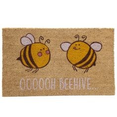Bee OOOOOH BEEHIVE Coir Door Mat. ​ Made from robust natural coir fibre with a durable rubber backing  Dimensions: Height 36cm Width 76cm Depth 2cm ​ Delivery prices available on Checkout