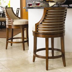 Cozy up to the counter in the quick ship Cabana Swivel Counter Stool. The horizontal back slats in Bali sun-drenched sienna, cushioned seat, and upholstered back blend comfort and cool design so you can sit and relax.