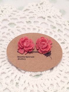 A personal favourite from my Etsy shop https://www.etsy.com/au/listing/492315178/stud-earrings-coral-pink-rose-cameo