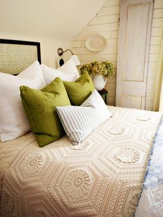 Bring a handmade feel and sense of history to a space with a vintage crochet bedspread, heirloom quilt or an all-white matlasse or coverlet. Look for spreads that are machine washable and relatively free of holes or stains.