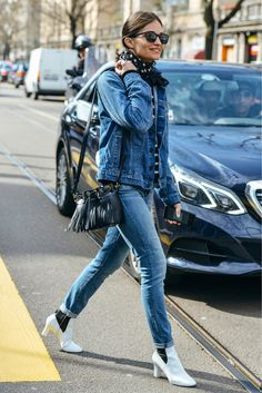 Maria Dueñas Jacobs mixed her basic jacket and jeans with black-and-white extras: Louis Vuitton boots, a Saint Laurent bag, and a polka-dot scarf.