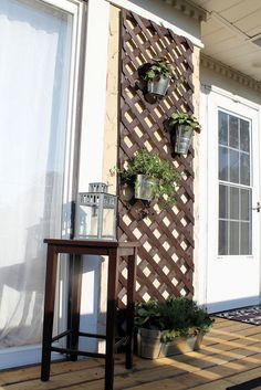 Hammers and High Heels: Alex's DIY Home Fixes   -   this lattice would be neat to put hooks on to hang beach towels and swimsuits, or plants as pictured, or any other hanging outdoor decor. Good for small spaces