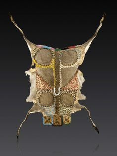 Africa   A Zulu Ingcayi, Beaded Pregnancy Apron.  Msinga, South Africa   ca. 1st half of the 20th century   Duiker hide, glass beads and brass buttons.   Beaded antelope skins were worn by new brides, whether pregnant or not, for a year after marriage to signal they were ready to bear children. She would then wear the apron over her belly during her pregnancy. The pelt would have been taken from an animal sacrificed to honour the paternal ancestors asking them to protect the unborn child.