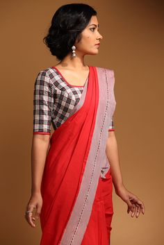 This formal blouse made from the Kavaya thuni has a button down back to add to the classic look. The black and white blouse is offset with the blood red Manjadi Blouse Designs Silk, Choli Designs, Saree Blouse Patterns, Kalamkari Blouse Designs, Trendy Sarees, Simple Sarees, Beautiful Blouses, Beautiful Saree, Saree Styles