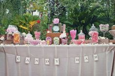 Wedding candy bar with cute apothecary jars.
