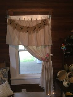 No sewing required! Canvas blanket and scrap canvas drop cloth close pinned to string makes a great country chic curtain!