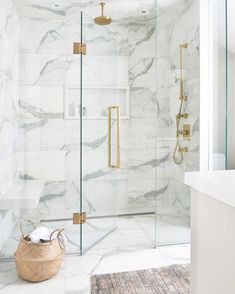gold Bathroom Decor Luxurious white and gray marble shower with a white niche enclosed with glass doors and brass hardware. Marble Tile Bathroom, White Marble Bathrooms, Marble Showers, Gold Bathroom, Master Bathroom, Tile Bathrooms, Bathroom Accents, Shiplap Bathroom, Master Shower