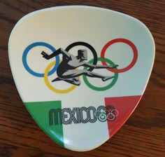Official 1968 Mexico Olympics plastic trivet by CnWsTexasTreasures on Etsy