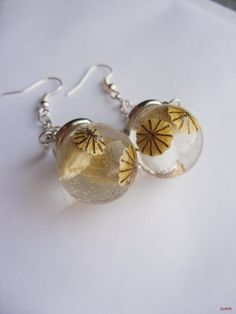 Glass orb earrings with poppy pods in resin by zusnA on Etsy