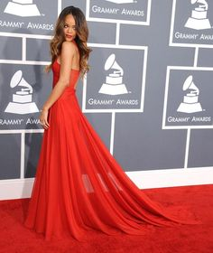 Rihanna looked practically goddess-like in a fire-engine-red gown that showed off her arms, shoulders, back, and whittled waist (and, with certain sheer areas, a bit more).