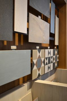 Boutique Tile Showroom for national tile retailer with bespoke display units both fixed and freestanding/ movable units designed in house by je+1.  #tiles #retaildisplay #bespokedesign #retailstore
