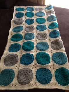 I have completed the retro circles crochet blanket! Cot size, love it!