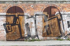 Two closed gates in old building in Zabłocie , district of the Krakow city in Poland