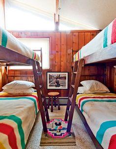 Love this cabin full of Hudson Bay blankets