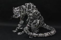 My pop tab sculptures have been my most popular concept. I should not have chosen this pose, though. Pop Top Crafts, Soda Tab Crafts, Pop Can Tabs, Tin Can Art, Soda Tabs, Pop Cans, Scrap Metal Art, Sculptures, Lion Sculpture