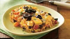 Cheesy Chicken-Tortilla Lasagna - Southwest ranch veggie dip adds creaminess and spice to a mouth-watering Mexican casserole.