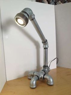 I want to build a lamp like this. Conduit Lighting, Pipe Lighting, Industrial Lighting, Industrial Pipe, Lighting Design, Pipe Furniture, Diy Furniture Projects, Metal Pipe, Iron Pipe