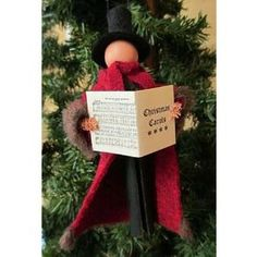 Christmas Caroler www.teeliesfairygarden.com Christmas will never be complete without this Christmas caroler. In fairyland, there are a lot of good fairy singers to join in to be one of the Christmas carolers. #fairychristmas