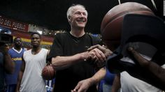 Arkansas Gov. Asa Hutchinson shakes hands with a basketball player in Havana, Cuba, on Tuesday, September 29. Hutchinson has urged Congress to allow food companies to sell to Cuba on credit, favoring it as a first step in a gradual repeal of sanctions.