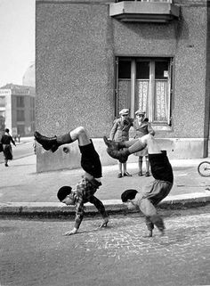 Henri Cartier Bresson - childrens play - world unlike - making the pin - race in street