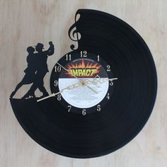 Handcarved Tango silhouette vinyl record clock by TikalTextiles