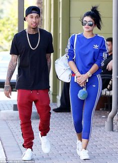 Casual: The 18-year-old reality star wore a blue Adidas tracksuit for the outing...
