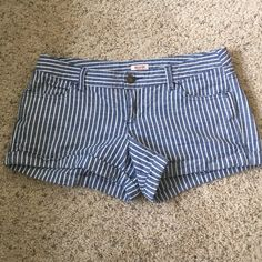 Striped Shorts Cute lightweight blue and white striped shorts by Mossimo - perfect for summer. 98% cotton, 2% spandex. Size tag confuses me as it says 9, FIT 6 (see photo) - basically fits a women's 4/6 Mossimo Supply Co Shorts